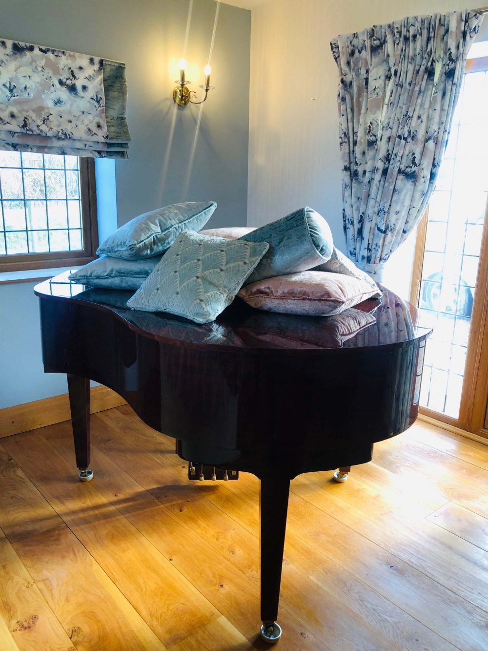 velvet cushions on a piano